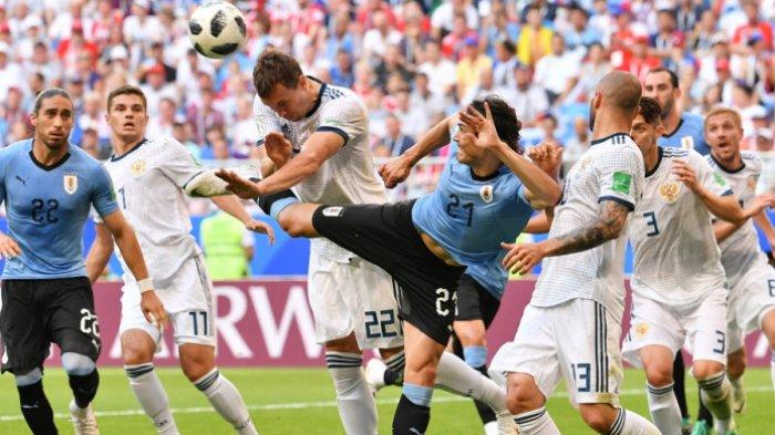 aksi-striker-timnas-uruguay-edinson-cavani_20180625_234421
